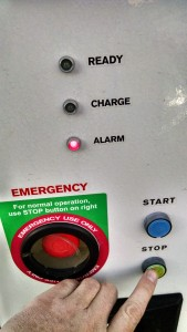 Press and hold the small green stop button