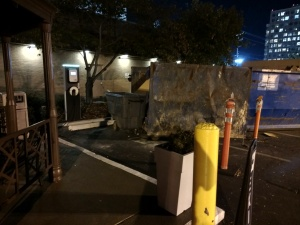 Both Blink charging stations blocked by construction dumpster.